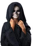 Teen with make-up of skull in black cloak laughs Royalty Free Stock Photography