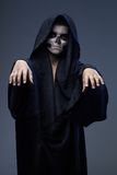 Teen with makeup skull cape stretched arms forward Stock Photos