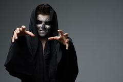 Teen with makeup skull cape wants  grab Stock Images