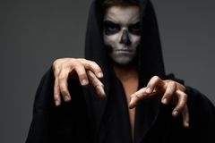 Teen with makeup skull cape wants  grab Stock Image