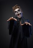 Teen with makeup skull cape wants  grab Royalty Free Stock Photos