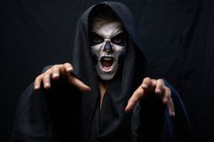 Teen with makeup skull cape wants  grab Royalty Free Stock Photo