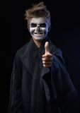Teen with makeup skull showing thumbs up Royalty Free Stock Photography