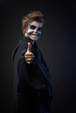Teen with makeup skull showing thumbs up Stock Images