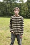 Teen Male in Field Stock Photo