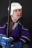 Teen male hockey player. With helmet, gloves, and stick Royalty Free Stock Photos