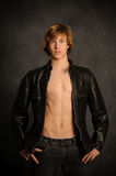 Teen Male in Leather Jacket. Healthy Caucasian Teen Male Waist Up Stock Photo