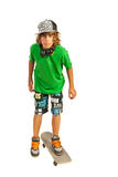 Teen male on skateboard Stock Images