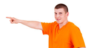 Teen man pointing in side Stock Photo
