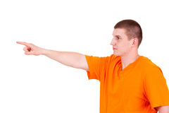 Teen man pointing in side Stock Photography