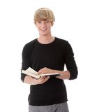 Teen man reading book Stock Image