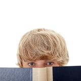 Teen man reading book Stock Images