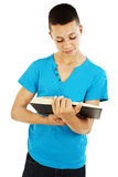 Teen man reading book Stock Photos