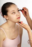 Teen and mascara Royalty Free Stock Images