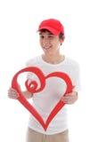 Teen med uppnosig blinkning för förälskelsehjärta arkivbild