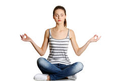 Teen meditating in lotus pose Royalty Free Stock Photography