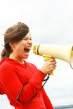Teen and a megaphone. Young teen yelling through a speakerphone Stock Photos