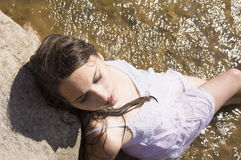Teen mermaid girl in the lake Royalty Free Stock Photos