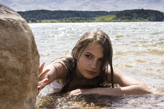 Teen mermaid girl in the lake Stock Images