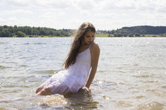 Teen mermaid girl in the lake Stock Photo