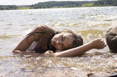 Teen mermaid girl in the lake Royalty Free Stock Photos