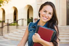 Teen Mixed Race Girl Student with School Books On Campus stock images