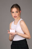 Teen model showing white card. Close up. Gray background Stock Photos