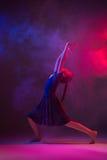 The teen modern ballet dancer. The female teen modern ballet dancer on blue and pink studio background royalty free stock photo