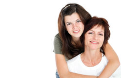 Teen and mom. Middle aged mom and teen daughter portrait in studio Royalty Free Stock Photography