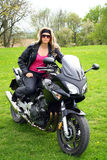Teen on motorbike. Young woman on a black motorcycle stock images