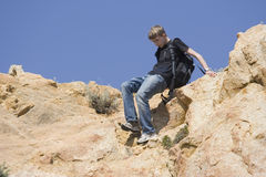 Teen mountaineering. Focus is on the legs - adobe RGB Stock Images