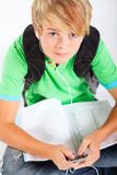 Teen with mp3 player Royalty Free Stock Photography