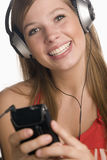 Teen with MP3 player and earphones Royalty Free Stock Photos