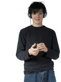 Teen music #7. Isolated teen with mp3 Royalty Free Stock Photos