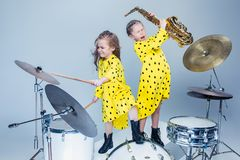 The teen music band performing in a recording studio. Teen music girls performing in a recording studio. The group of two girls standing together. Studio royalty free stock photos