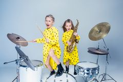 The teen music band performing in a recording studio. Teen music girls performing in a recording studio. The group of two girls standing together. Studio Royalty Free Stock Images