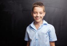 Teen near blackboard Royalty Free Stock Image