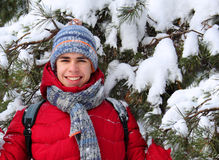 Teen near a snow-covered tree Stock Photography