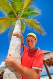 Teen and palm tree Royalty Free Stock Photography