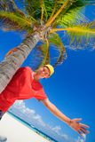 Teen by palm tree Stock Image