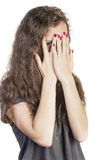 Teen Peeking thorugh fingers. A Teen Peeking thorugh fingers her fingers with red nails Stock Images