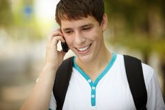 Teen on the phone Stock Images