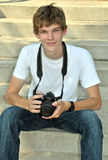 Teen Photographer Portrait. A teen boy and his camera rests on a set of steps Royalty Free Stock Images