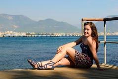The teen on a pier Royalty Free Stock Photos