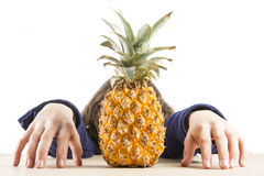 Teen with pineapple. A teenage girl with a pineapple isolated on a white background Royalty Free Stock Image