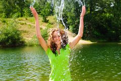 Teen play with water. On hot day Stock Images