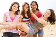 Teen playing. Group of teen girls playing on beach Stock Photos