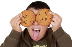 Teen playing with cookies royalty free stock images