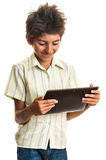 Teen playing games on tablet Royalty Free Stock Photos