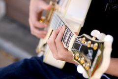 Teen playing a guitar Stock Photography